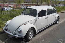 yellow volkswagen beetle royalty free white volkswagen beetle stretched limousine stock photo picture