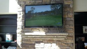 installing flat screen tv above gas fireplace mounting brick hang