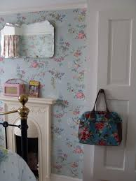 Small Victorian Bedroom Fireplace Small Bedroom Fireplace Surrounded By Blue Floral Wallpaper