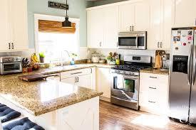 snow white milk paint kitchen cabinets diy painting our kitchen cabinets with white milk paint