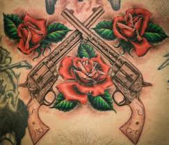 long gun tattoo with red roses flower tattoos of course would