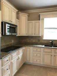 creamy off white painted kitchen cabinets with brown glaze