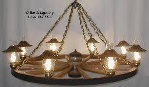 wagon wheel light fixture ww027 wagon wheel chandeliers with hurricane uplights