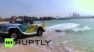 amphibious jeep uae amphibious cars tear up water in dubai u0027s palm beach land sea
