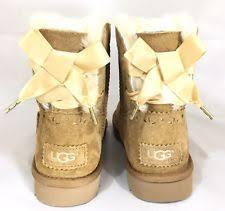 s ugg australia mini bailey bow boots ugg australia dixi flora perf mini bow port purple fur boots size