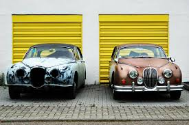 jaguar cars two parked new and destroyed antiques jaguar cars high