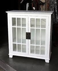 white bookcase with doors
