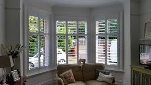 shutters for bay windows living room carameloffers
