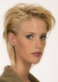 short hair with irregular strands and styled behind the ears with gel