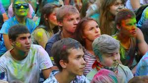 happy dirty girls and boys during festival of color holi stock