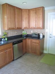 custom kitchen cabinets built in oven black wooden countertop