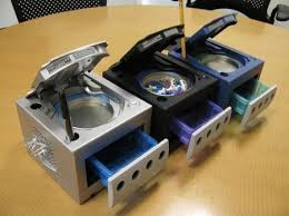 desks for gaming consoles outdated gaming console nintendo gamecubes recycled into office