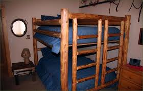 kids bedroom rustic bunk bed ideas with log frame and blue sheet