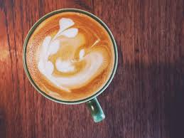 coffee shop background design hot coffee with latte art on table in coffee shop for background or
