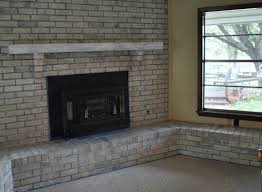 painted brick fireplace with grey paint color brick stone