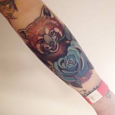blue rose and red panda tattoo on left forearm