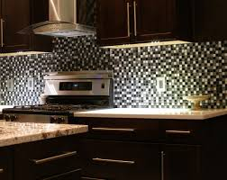 backsplashes kitchen counter with bar stools dark cabinets in a