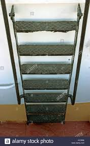 old metallic ladder stairs on boat ship vessel storage tank