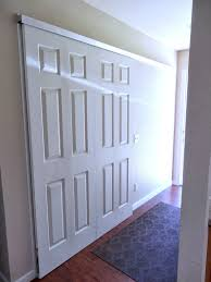 Bipass Closet Doors by Interior White Wooden Sliding Closet Door On White Brown Walls As