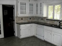 white kitchen cabinets black tile floor white cabinets and ceramic floors