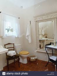 Bathroom In French by Large Painted Mirror In French Country Bathroom With White Towels