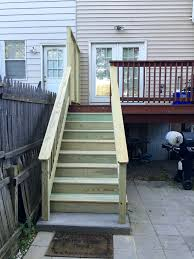 replacing the deck stairs eclectically grey