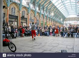 a juggling street entertainer performing to crowds indoor at