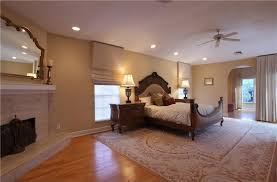 traditional guest bedroom with ceiling fan hardwood floors in