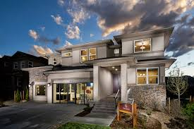 contemporary design changes with the times professional builder the boxy exterior is broken up with stucco stone and brick bands of windows and a second floor deck the price starts at 663 000 for 3 946 square feet