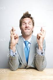 Fingers Crossed Meme - hopeful businessman crossing fingers and closing eyes stock photo