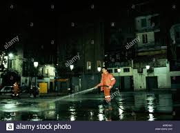 jose monteagudo cleaning down the streets of the barrio chino