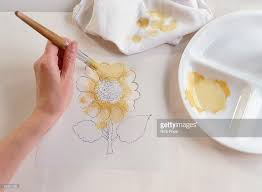 Pale Yellow Paint Hand Blotting Pale Yellow Paint Onto Petals Of Sunflower Stencil