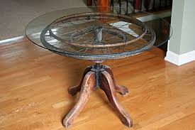 repurposed table top ideas old piano stool plus wheelchair wheel and glass top recycle