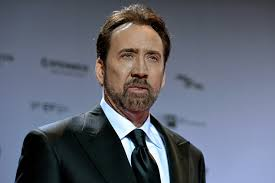 Nicolas Cage Meme - nicholas cage stoically posing in kazakhstan s traditional attire is