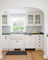 White Kitchen Cabinets And Black Countertops by Another Sample Of Gray Chevron Backsplash With Black Counter Tops