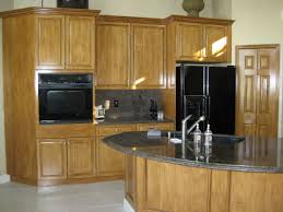 light brown wooden kitchen cabinet with floating white storage on
