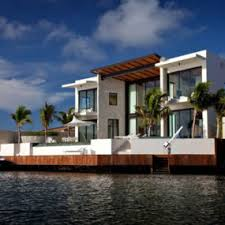 Coastal House Design Luxury Glass And Stone Home - Luxury design homes