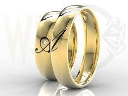 obraczki slubne obrączki ślubne złote z brylantem 0 02ct para z inicjałami