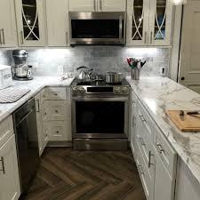 white kitchen cabinets laminate countertops shaker white cabinets paired with 180fx laminate calacatta