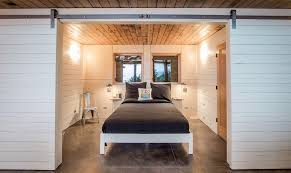 white painted wood paneling bedroom rustic with built in storage