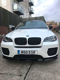 white wrapped cars bmw x6m wrapped pearl white khaz customs