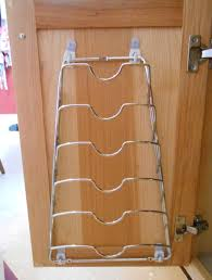 use command hooks to attach lid rack to inside of cabinet door for