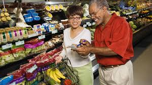 how to extreme coupon save on groceries extreme couponing 101 older couple at the supermarket