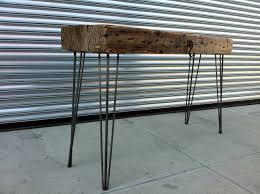 koff designs makes modern tables out of locally sourced reclaimed