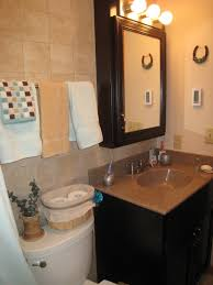 Storage For Towels In Small Bathroom by Bathroom Ceramic Tile Bathroom With Towel Rack And Framed Mirror
