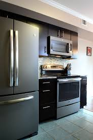 white kitchen cabinets with black slate appliances consumers go gray in a stylish way with ge slate kitchens