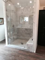 frameless shower with a door fixed panel fixed notched panel