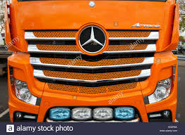 orange mercedes front of an orange mercedes actros lorry cab stock photo royalty
