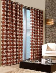 orange patterned curtains of floral patterns in 2 panels orange