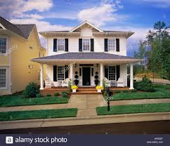 house with porch small two white house with black shutters brick porch stock